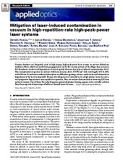 Mitigation of laser-induced contamination in vacuum in high-repetition-rate high-peak-power laser systems